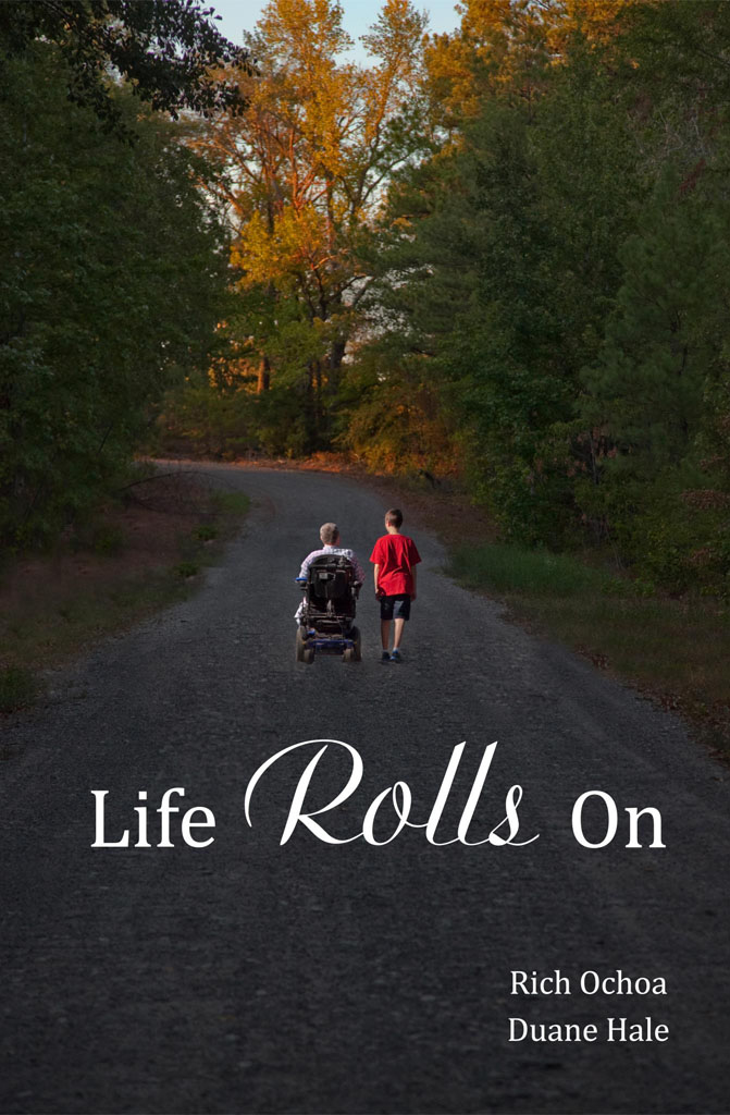 Duane Hale in his wheelchair driving down a country road accompanied by his young son, Logan, on a beautiful Fall day.